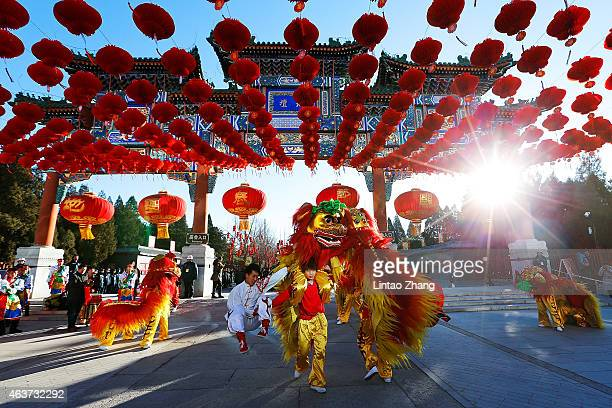Chinese folk artists perform during the opening ceremony of the Spring Festival Temple Fair at the Temple of Earth park on February 18 2015 in...
