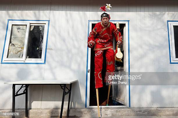 Chinese folk artists prepare to perform during the opening ceremony of the Spring Festival Temple Fair at Dragon Lake Park on February 9, 2013 in...