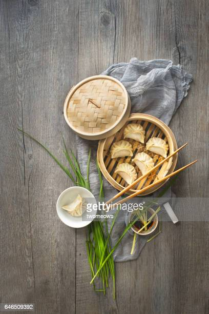 Chinese food dumpling on rustic wooden table top.
