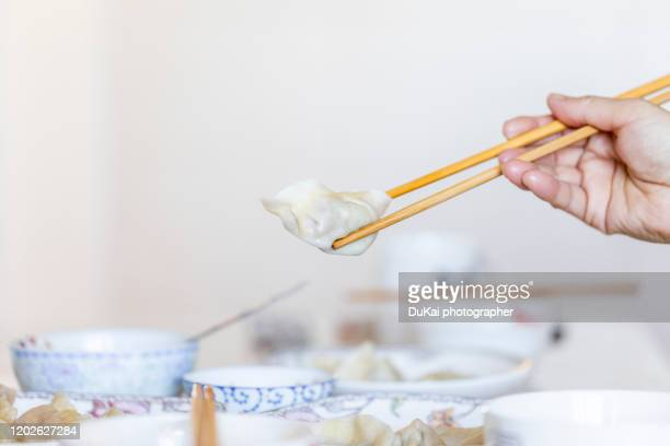 chinese food dumplings - chopsticks stock pictures, royalty-free photos & images