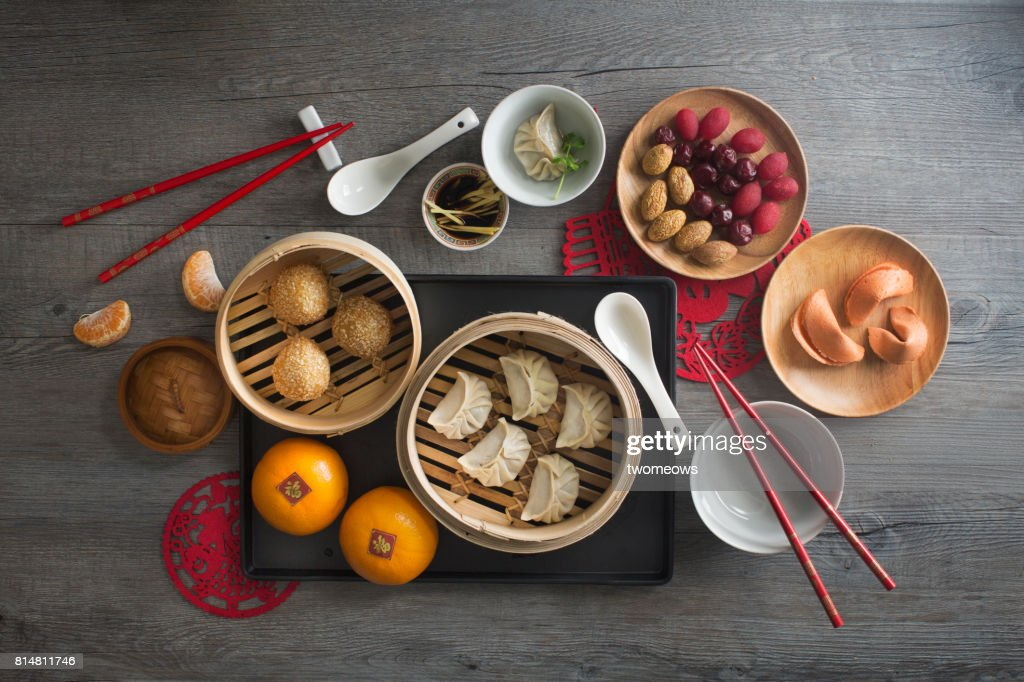 Chinese food steamed dumpling and tea served on rustic wooden background. : Stock-Foto