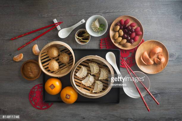 Chinese food steamed dumpling and tea served on rustic wooden background.