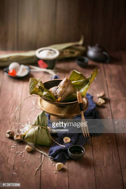 chinese food sticky rice dumpling (zhong zi). - salted stock photos and pictures