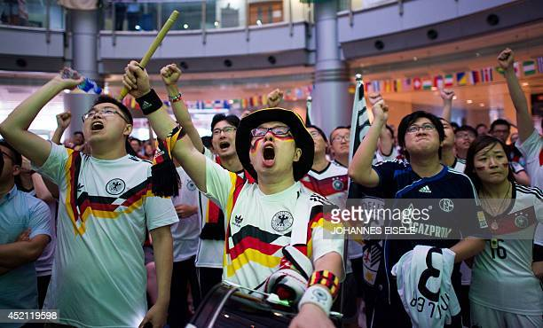 Chinese football supporters react during the final of the 2014 FIFA World Cup in Brazil between Germany and Argentina at a public viewing event at...