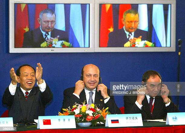 Chinese Foreign Minister Li Zhaoxing Russian FM Igor Ivanov and VT Casymov Executive Director of the SCO AntiTerrorism Center react to a speech...