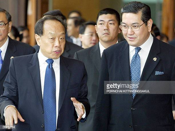 Chinese Foreign Minister Li Zhaoxing speaks with Thai Foreign Minister Surakiart Sathirathai ahead of their bilaterial meeting in Bangkok 21 October...