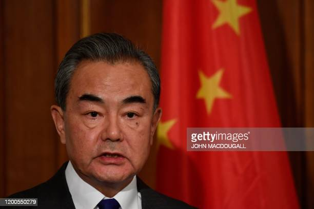 Chinese Foreign Minister Wang Yi addresses a joint press conference with the German foreign minister after talks on February 13, 2020 at the German...