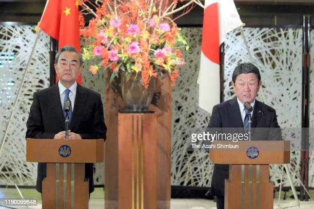 Chinese Foreign Minister Wang Yi and Japanese Foreign Minister Toshimitsu Motegi attend a joint press conference following their meeting at the...