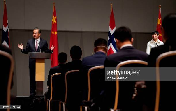 Chinese Foreign Minister Wang Yi and Norway's Foreign Minister Ine Eriksen Soreide attend a press conference after talks during a visit to Norway on...