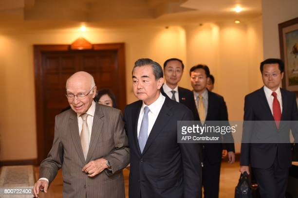 Chinese Foreign Minister Wang Yi and Pakistani Advisor to the Prime Minister on National Security and Foreign Affairs Sartaj Aziz arrive for a press...