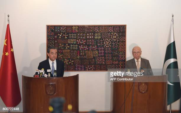 Chinese Foreign Minister Wang Yi and Pakistani Advisor to the Prime Minister on National Security and Foreign Affairs Sartaj Aziz attend a press...