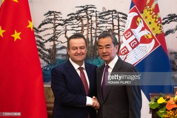 Chinese Foreign Minister Wang Yi and Serbian Foreign Minister Ivica Dacic shake hands after a joint press conference following their meeting at...
