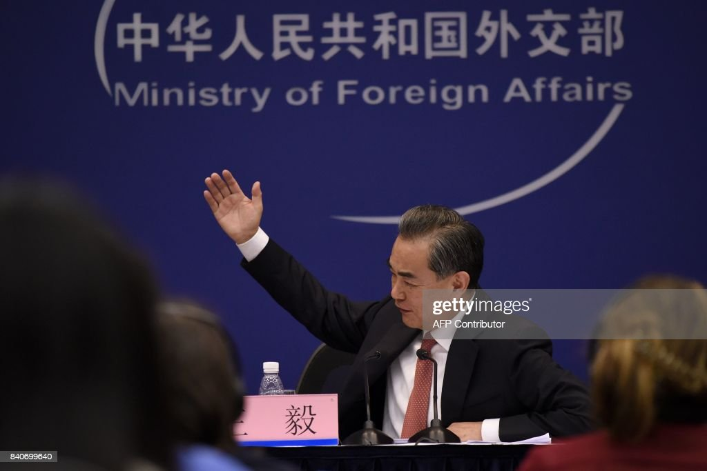 Chinese Foreign Minister Wang Yi answers a question during a press conference in Beijing on August 30, 2017. China is working with other members of the United Nations Security Council on a response to North Korea's missile launch over Japan, the Chinese foreign minister said on August 30. /