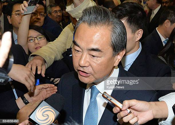 Chinese Foreign Minister Wang Yi answers reporters' questions at the ministry in Beijing on May 27 ahead of US President Barack Obama's historic...