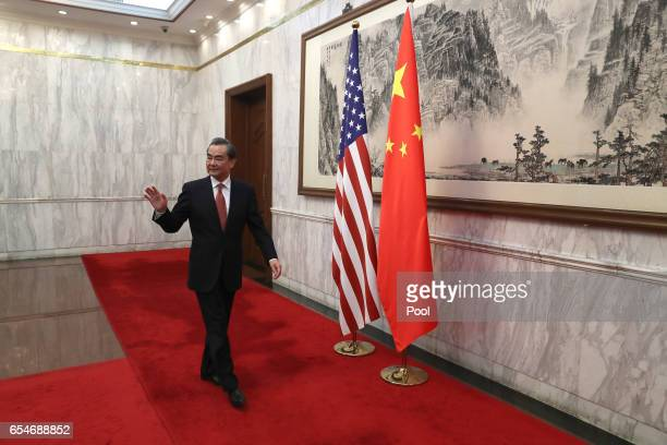 Chinese Foreign Minister Wang Yi arrives for a bilateral meeting with US Secretary of State Rex Tillerson not shown at the Diaoyutai State Guesthouse...