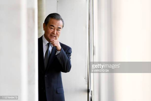 Chinese Foreign Minister Wang Yi gestures during a meeting with his Brazilian counterpart Ernesto Araujo at Itamaraty Palace in Brasilia on July 25...