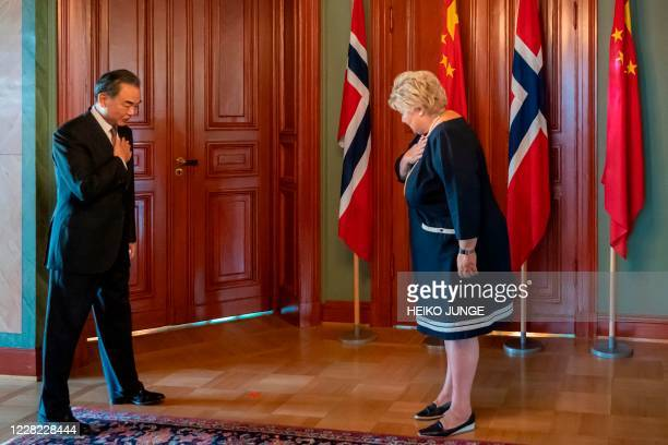 Chinese Foreign Minister Wang Yi greets Norway's Prime Minister Erna Solberg during a visit to Norway on August 27 2020 in Oslo / Norway OUT