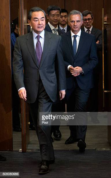 Chinese Foreign Minister Wang Yi left arrives with Swiss Foreign Minister Didier Burkhalter right for a joint press conference at the Ministry of...