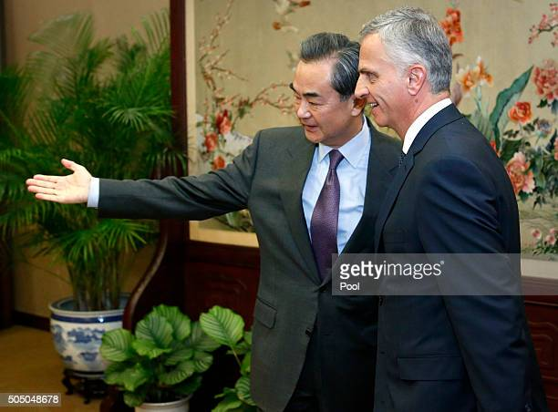 Chinese Foreign Minister Wang Yi left gestures to Swiss Foreign Minister Didier Burkhalter right before a bilateral meeting at the Ministry of...