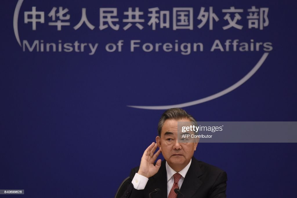 Chinese Foreign Minister Wang Yi listens during a press conference in Beijing on August 30, 2017. China is working with other members of the United Nations Security Council on a response to North Korea's missile launch over Japan, the Chinese foreign minister said on August 30. /
