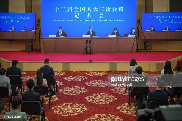 Chinese Foreign Minister Wang Yi, located at the Great Hall Of The People, answers to the questions from the press located at the Media Center,...