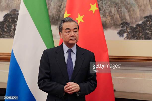 Chinese Foreign Minister Wang Yi looks as he waits for the arrival of Sierra Leone Foreign Minister Alie Kabba at the Diaoyutai State Guesthouse...