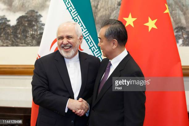 Chinese Foreign Minister Wang Yi meets Iranian Foreign Minister Mohammad Javad Zarif at Diaoyutai State Guesthouse on May 17 2019 in Beijing China