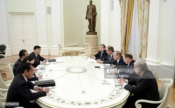 Chinese Foreign Minister Wang Yi meets Russian Foreign Minister Sergey Lavrov and Russian President Vladimir Putin at Kremlin Palace in Moscow Russia...