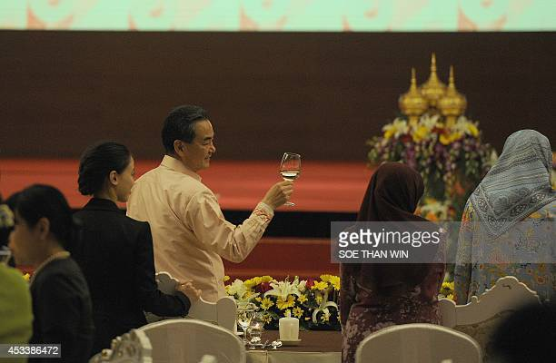 Chinese Foreign Minister Wang Yi raises his glass during a toast at the Association of Southeast Asian Nations gala dinner hosted by Myanmar's Union...