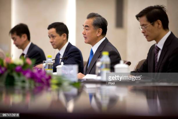 Chinese Foreign Minister Wang Yi second from right speaks during a meeting with Botswana's Minister of International Affairs and Cooperation Unity...