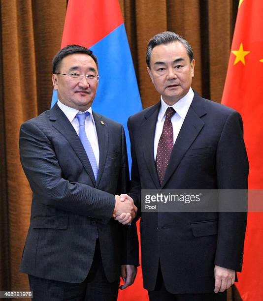 Chinese Foreign Minister Wang Yi shakes hands with Mongolian Foreign Minister Lundeg Purevsuren before a meeting at China's Ministry of Foreign...
