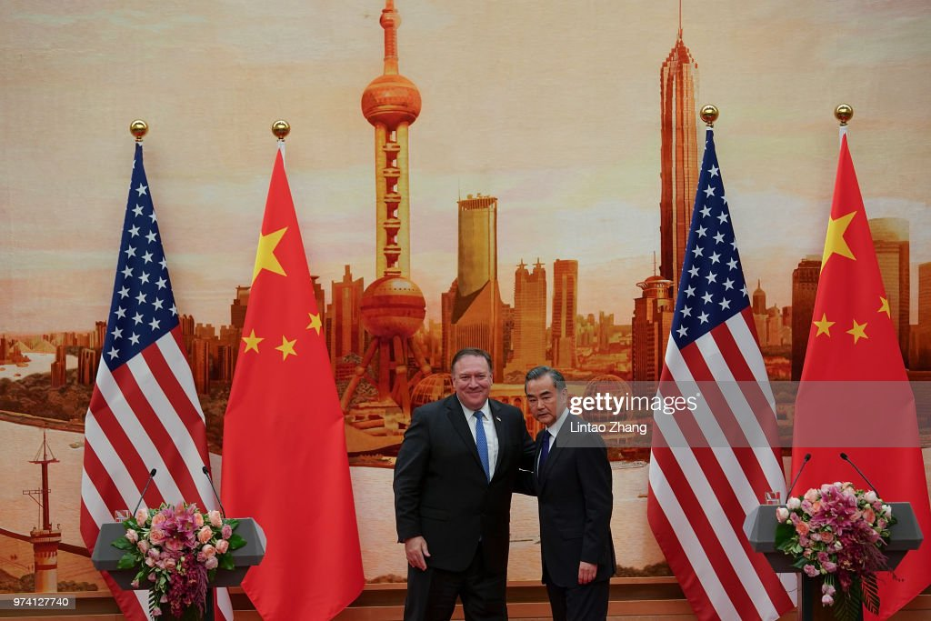 Chinese Foreign Minister Wang Yi (R) shakes hands with U.S. Secretary of State Mike Pompeo (L) during a press conference at the Great Hall of the People on June 14, 2018 in Beijing, China. U.S. Secretary of state Mike Pompeo is visiting China on the invitation of Chinese State Councilor and Foreign Minister Wang Yi