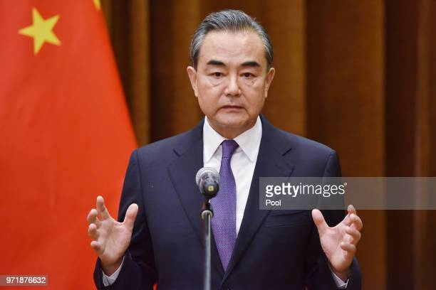 Chinese Foreign Minister Wang Yi speaks about the summit between US President Donald Trump and North Korean leader Kim Jong Un during a joint...