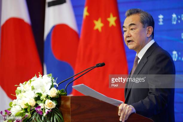 Chinese Foreign Minister Wang Yi speaks at the opening ceremony of the International Forum for Trilateral Cooperation that commemorates the 20th...