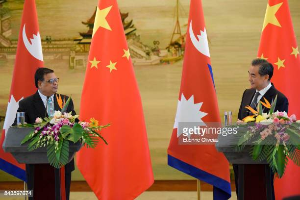 Chinese Foreign Minister Wang Yi speaks during a press conference following his meeting with Deputy Prime Minister Of Nepal Krishna Bahadur Mahara at...
