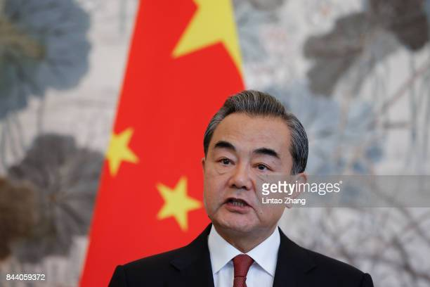 Chinese Foreign Minister Wang Yi speaks during a press conference with Pakistan Foreign Minister Khawaja Muhammad Asif at Diaoyutai State Guesthouse...