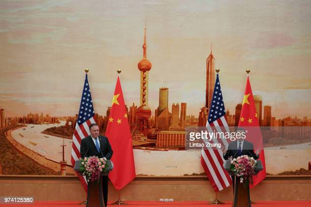 Chinese Foreign Minister Wang Yi speaks during a press conference with US Secretary of State Mike Pompeo at the Great Hall of the People on June 14...