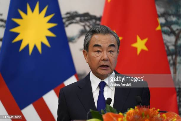 Chinese Foreign Minister Wang Yi speaks during the press conference at the end of the meeting with Malaysian Foreign Minister Dato' Saifuddin...