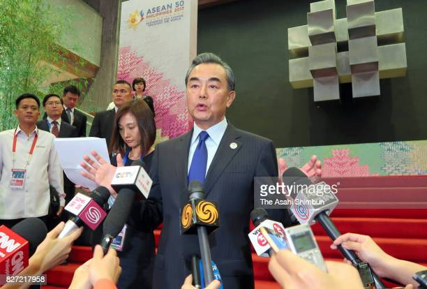 Chinese Foreign Minister Wang Yi speaks to media reporters piror to the gala dinner of the Association of Southeast Asian Nations Foreign Ministers...