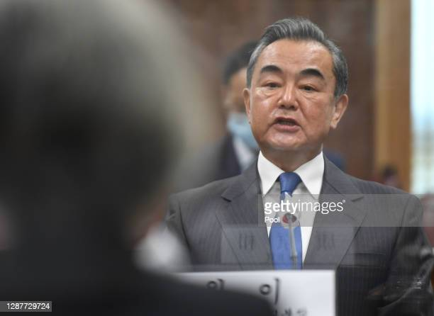 Chinese Foreign Minister Wang Yi talks with South Korea Foreign Minister Kang Kyung-wha during their meeting at foreign ministry on November 26, 2020...