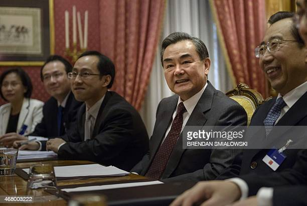 Chinese Foreign Minister Wang Yi waits before the start of a meeting with the US Secretary of State and others at the Beau Rivage Palace Hotel on...