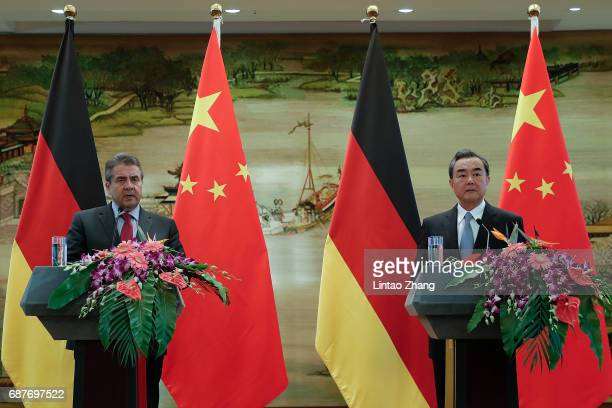 Chinese Foreign Minister Wang Yi with German Foreign Minister Sigmar Gabriel attends a press conference at the foreign ministry on May 24 2017 in...