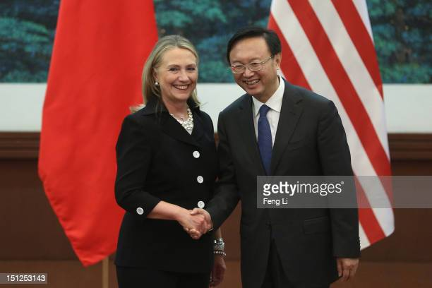 Chinese Foreign Minister Yang Jiechi and U.S. Secretary of State Hillary Clinton shake hands after attending the press conference at the Great Hall...