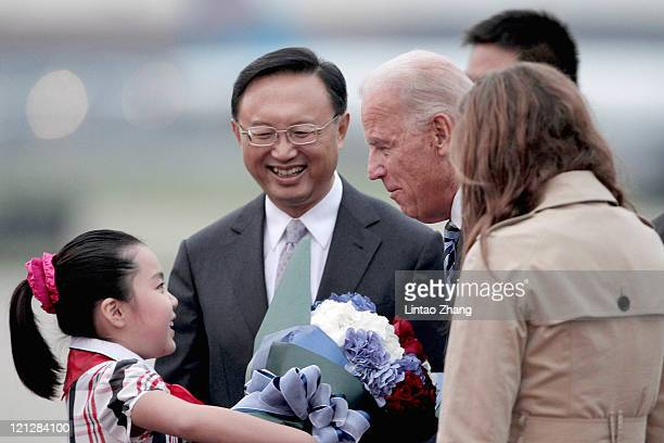 Chinese Foreign Minister Yang Jiechi meets US Vice President Joe Biden and his granddaughter Naomi Biden at the Beijing Capital International Airport...
