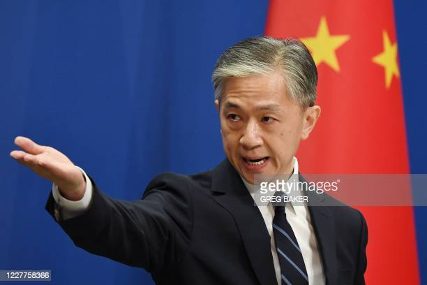 Chinese Foreign Ministry spokesman Wang Wenbin takes a question during the daily Foreign Ministry briefing in Beijing on July 24, 2020. - China on...