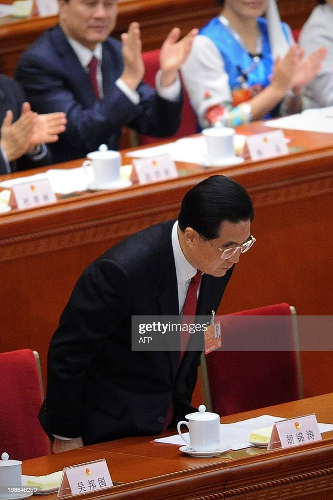 Chinese former president Hu Jintao bows to the delegates as President Xi Jinping delivers his maiden speech at the closing session of the National People's Congress (NPC) at the Great Hall of the People in Beijing on March 17, 2013. Newly-elected Chinese President Xi Jinping said he would fight for a 'great renaissance of the Chinese nation', in his first speech as head of state of the world's most populous country.
