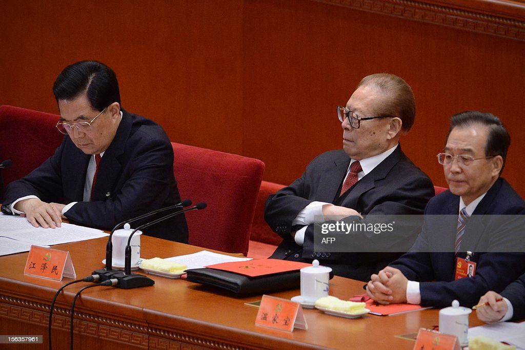 Chinese former president Jiang Zemin (2nd R) looks at the Chinese president Hu Jintao (L) during the closing of the 18th Communist Party Congress at the Great Hall of the People in Beijing on 14 November, 2012. The week-long Communist Party Congress will end with a transition of power to Chinese Vice President Xi Jinping, who will govern for the coming decade amid growing pressure for reform of the communist regime's iron-clad grip on power.