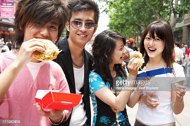 Chinese friends eating fast food together
