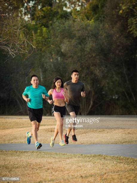 Chinese friends jogging in park