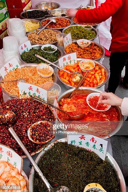 chinese gabbage, peanuts, bamboo shoots and radish on sale. - andre vogelaere stock pictures, royalty-free photos & images